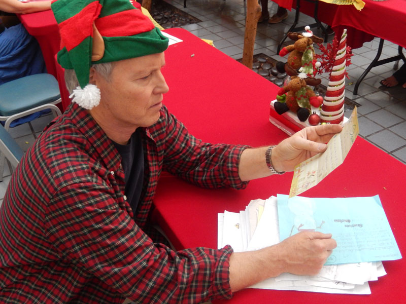 Elf patrick voluneteers and reads letters